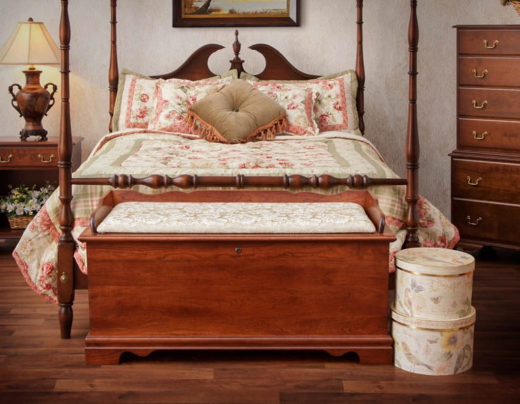 a cedar chest sitting at the foot of a bed is a creative use for a cedar chest