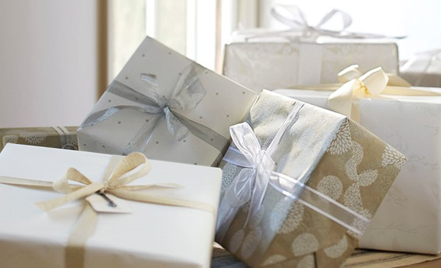a pile of wrapped expensive wedding gift packages
