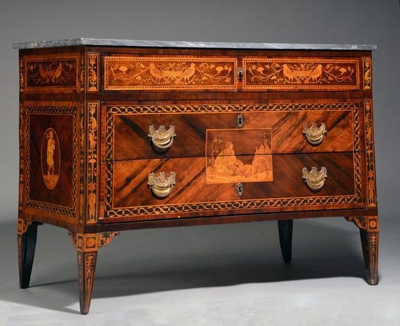 A Vintage Chest With 4 Drawers And It's Antique Designs Makes it Valuable