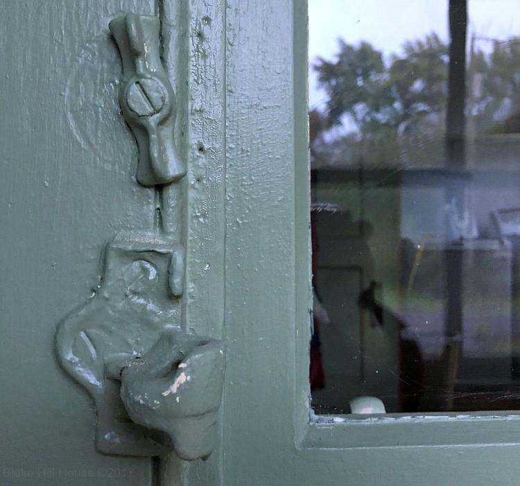 An Old Painted Door Hardware Such As Door Lock and Door Handle