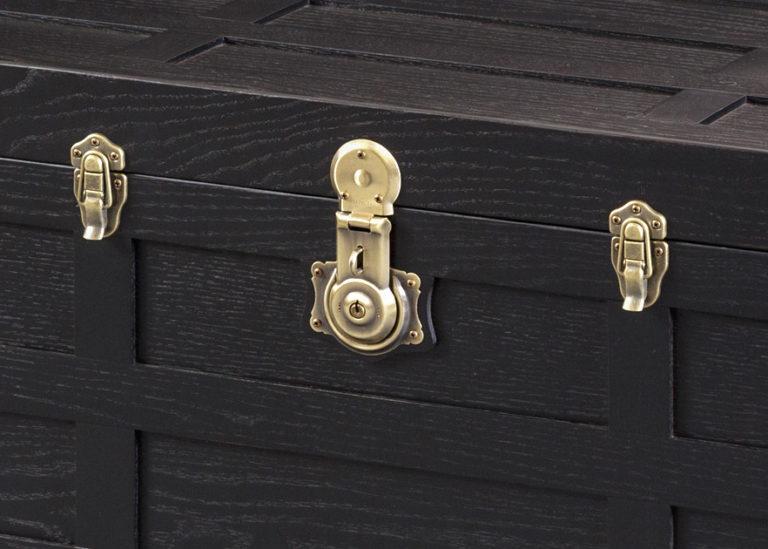 antique brass hardware on black oak steamer trunk